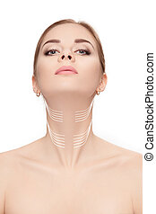 woman with arrows on face over white background. neck lifting co