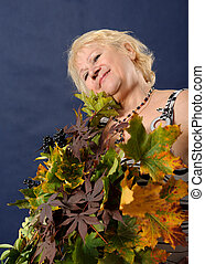 Woman with autumn leaves.