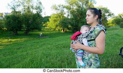 Woman with baby in nature.