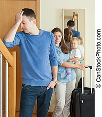 Woman with baby leaving home