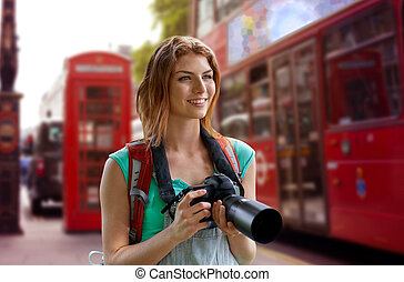 woman with backpack and camera over london city