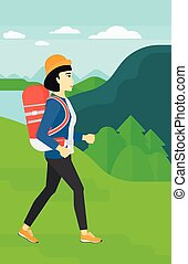 Woman with backpack hiking.