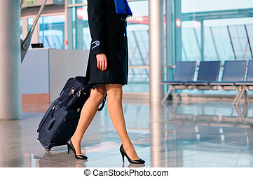 Woman with bag at airport - Unrecognizable business women...