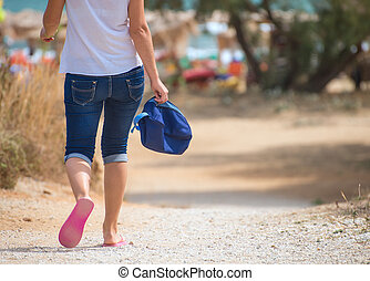 Woman with bag going to the beach.