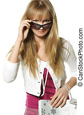 Woman with bag looking over sunglasses