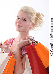 Woman with bags full of purchases