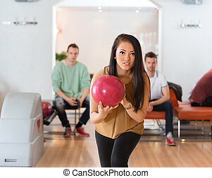 Woman With Ball Bowling in Club
