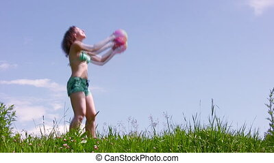 Woman with ball on grass