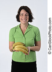 woman with banana on white background