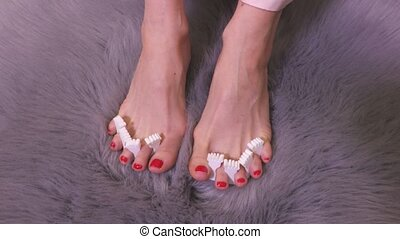 Woman with bare feet on fur faux rug