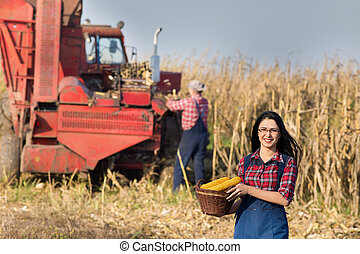 Woman with basket in corn field