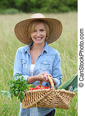 Woman with basket of vegetables