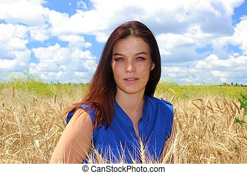 Woman with beautiful eyes on a whea