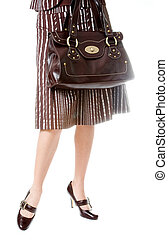 woman with beautiful legs holding bag