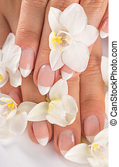 Woman with beautiful manicured nails.