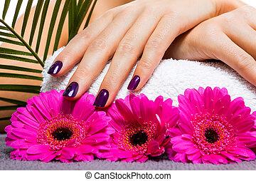 Woman with beautiful manicured purple nails