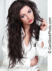 Woman with beauty long brown hair posing at studio