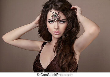 Woman with beauty long brown hair. Jewelry and Beauty. Fashion art photo