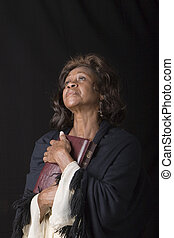 Woman with Bible to Chest
