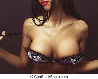 Woman with big breasts in elegant bra