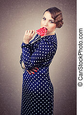 woman with big lollipop in retro style