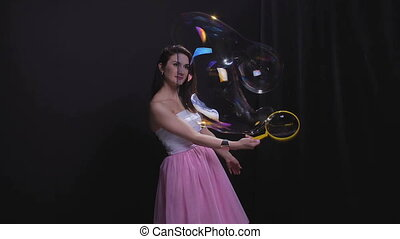 Woman with big soap bubble - Woman with soap bubbles, bullet...