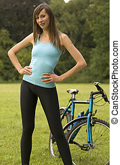 Woman with bike outdoor