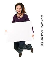 woman with billboard jump