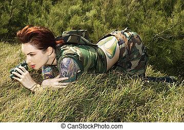 Woman with binoculars. - Attractive tattooed Caucasianwoman...