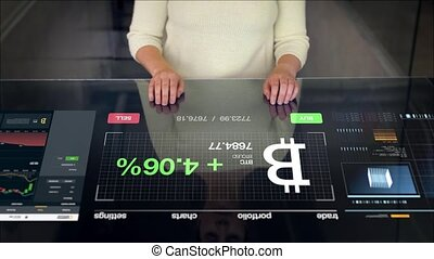 woman with bitcoin projection on interactive panel