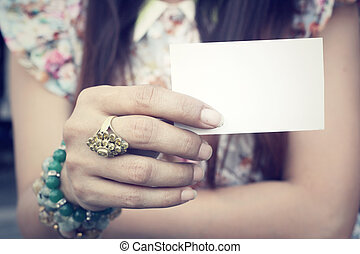 Woman with blank card