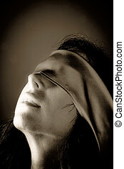 woman with blindfold - a young woman with fastened eyes. ...