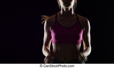 Woman with blond hair runs on a black screen. Close up -...