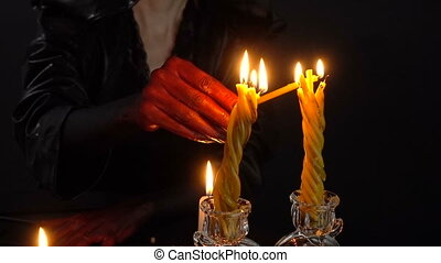 Woman with blood hands lights candles - Footage of woman...