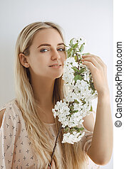 Woman with Blossoming Tree Branch on White Background