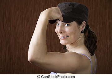 Woman with blue eyes flexing her muscle