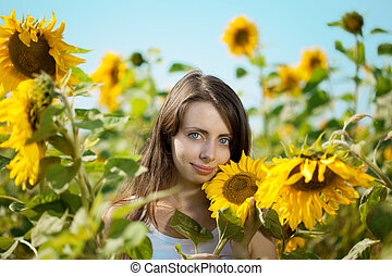 Woman with blue eyes with sunflowers - Woman with big blue...