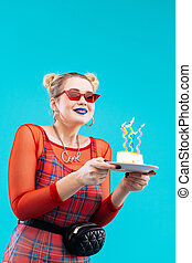 Woman with blue lips feeling excited celebrating birthday