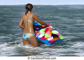Woman with bodyboard  in the sea
