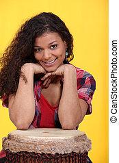 Woman with bongo drum