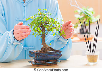 Woman with bonsai tree