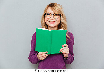Woman with book smiling