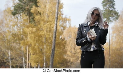 Woman with book walking in park