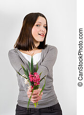 woman with bouquet of flowers flirting