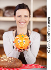 Woman with bread and piggy bank