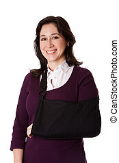 Woman with broken arm in sling - Happy attractive woman with...