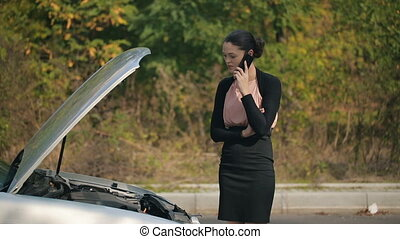 Woman with broken car calling by the phone - Road trip car...