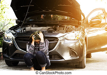 Woman with broken car