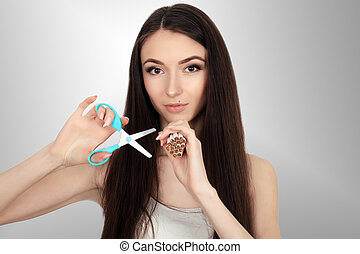 Woman with broken cigarette - stop smoking concept