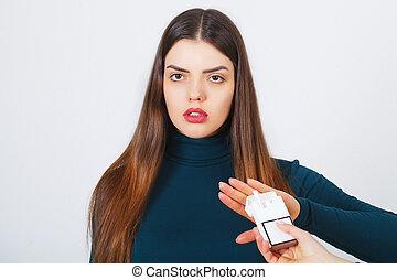 Woman with broken cigarette - stop smoking concept